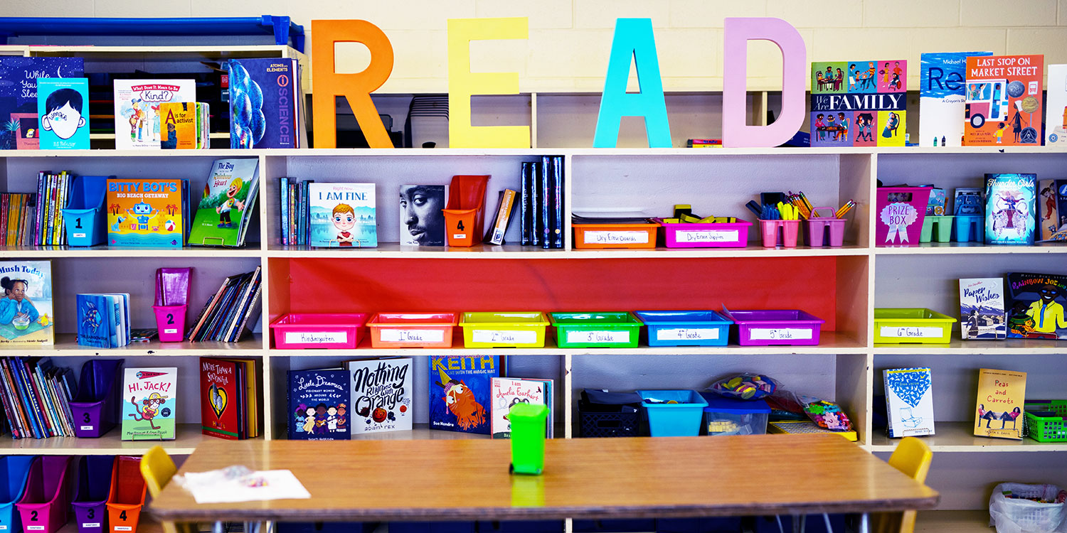 Reading wall with bookshelf and materials.