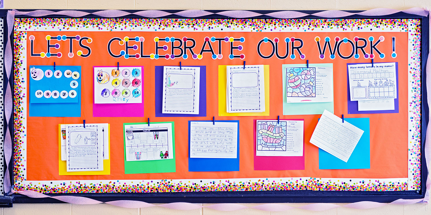 """Bright bulletin board that says """"Let's Celebrate Our Work"""""""